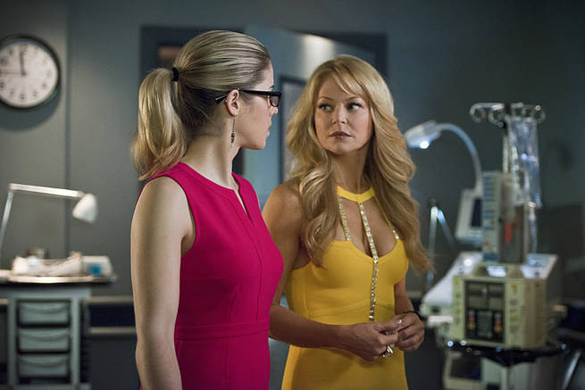 "Emily Bett Rickards and Charlotte Ross in the Arrow episode ""Public Enemy."" Photo Credit: Diyah Pera/The CW"